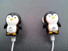 Itty Bitty Penguin earbuds with glitter and a swarovski crystal. $10.00, via Etsy.