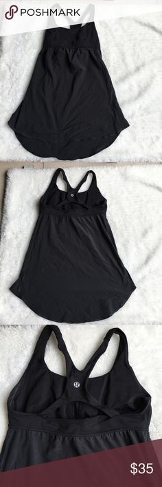 Lululemon Black Tank Top size 6 Preowned authentic Lululemon Black Tank Top size 6. Has builtin bra. Please look at pictures for better reference. Happy shopping lululemon athletica Tops Tank Tops