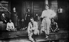 Robert Lewis Stevenson sits on his verandah in Vailima, Samoa. He moved to Samoa to recover from ill health and died an is buried there. Here he is with his mother, wife and servants.