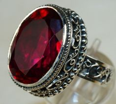 RING - FIRE RED MYSTIC TOPAZ Head Size : 7/8 in. x 5/8 in. STERLING FIRE RED MYSTIC TOPAZ RING, SIZE 6, 30 CARAT STONE. Price: $185 -This seams like a good bargain to me.