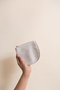 Baggu Small U Pouch in Stone Leather. The original small leather pouch is back by popular demand. Perfect for coins, keys and other small essentials. In the softest natural milled leather. Pouch is un