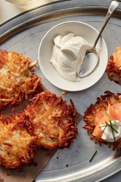 NYT Cooking: Perfect for Hanukkah or any time of year, these latkes bring out the pure flavor of potato, because that is basically the only ingredient in them. Making latkes can be a last-minute nightmare, with overeager cooks putting too many patties in hot oil, thus taking longer to fry and resulting in a greasy mess. But these can be prepared in advance. This recipe, adapted from the chef Nathaniel Wade ... Potato Latkes, Potato Pancakes, Potato Skins, Matzo Meal, Homemade Applesauce, Holiday Recipes, Christmas Recipes, Hanukkah Recipes, Christmas Buffet
