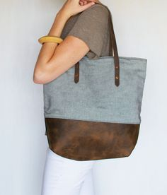 Kick butt carry all tote in reverse denim and leather! Reverse Mills Tote