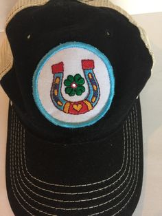 Women's black trucker style snapback cap with luck and love custom embroidered patch