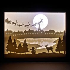 Find out how to make an amazing shadow box with light and a paper cut scenery! Find out how to make an amazing shadow box with light and a paper cut scenery! Christmas Shadow Boxes, Paper Christmas Ornaments, 3d Christmas, Christmas Travel, Shadow Light Box, Diy Shadow Box, Paper Cutting, Shadow Box Kunst, Box Noel