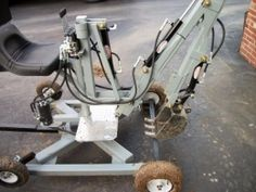 Mini Towable Backhoe - Homemade mini towable backhoe fabricated from cold rolled steel plate, flat bar, tubing, and angle iron. Hydraulic pump is powered by a 6 HP motor.