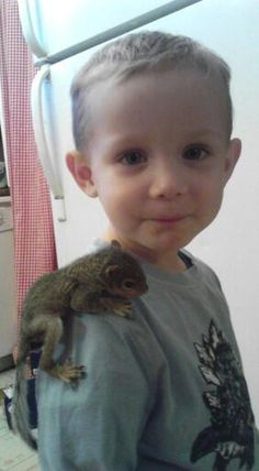 Starting a new trend, the over the shoulder squirrel! My precious nephew!