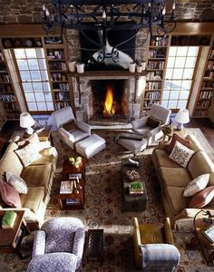 Rustic living room w/ stone fireplace / - -