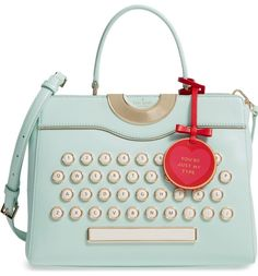 "Whether you're the fun, chatty type or the mysterious writerly type, you'll fall for this statement satchel by Kate Spade, featuring gilded keyboard letters, a duo of spacious compartments and an optional bag charm that reads ""You're just my type""."