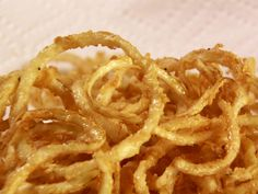 Onion Strings from FoodNetwork.com....made these and they are awesome. Way easier than making onion rings. If you don't have buttermilk make you own with one tablespoon white vinegar per one cup milk. You will love these.