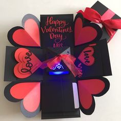 """Buy Explosion box with lighthouse, 4 waterfall in black & red in Singapore,Singapore. ----------- Info ------------- Size: 4x4"""" Explosion box card with - 2 layers - 4 customized photos at the base layer - a 3D lighthouse in the center with ba Chat to Buy"""