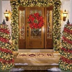Christmas outdoor decoration of house in night view Exterior decoration of house for Christmas with Santa Claus dolls and x mas trees wallpaper