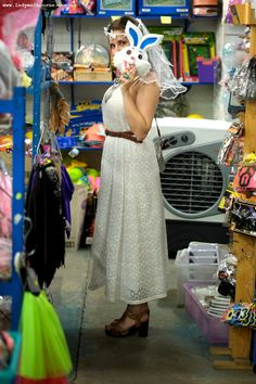 Lady Melbourne playing dress ups in a white lace dress