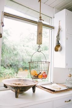 Hanging Fruit Basket in the Kitchen from Nathan Williams.  Love the idea of a scale to ld up a basket.  Need to look for one.