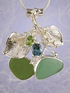 pinned from http://www.designerartjewellery.com   pendant with gemstones and seaglass
