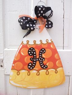 Adorable candy corn Halloween door hanger!  Free personalization.
