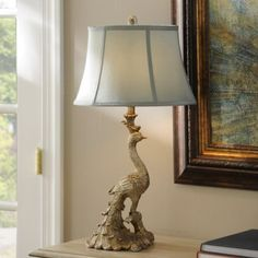 Sure to be the talk of any room, this peacock table lamp brings a certain majesty to your decor. An elegant addition to any table, you'll love our peacock lamp! Peacock Bedding, Peacock Bedroom, Unique Table Lamps, Peacock Decor, Peacock Theme, New Living Room, Glass Table, Light Decorations, Interior Decorating
