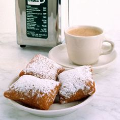 BEIGNETS |  French Acadians, or Cajuns, brought the beignet to the Louisiana, and this powdered sugar–piled, light-and-puffy fritter has been popular in New Orleans ever since.