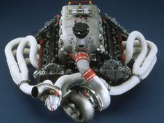"icantgetmyusernameonthisshit: "" Alfa Romeo turbocharged v8 for Indycar. This would be nice to shoehorn into a 75 Milano or GTV6 :D Details: 90-degree 8 cylinder V-shaped engine with aluminium..."