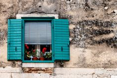 #building #croatia #cruise #flowers #house #nofilter #old #open #patina #red #shadow #shutters #split #town #travel #vacation #wall #window #windows #worn #yellow