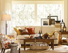 couch in front of window....   if couch is smaller scale, and pulled forward?  also lighter color?    Small Spaces | Pottery Barn