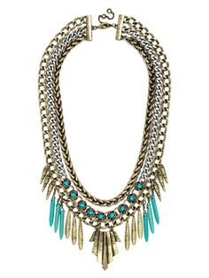 """ále by Alessandra Guest Bartender Collection. A formidable bib melds futuristic mixed metals with organic turquoise points for a galactic warrior-princess statement. Appearance of stones may vary. Necklace measures 18"""" with 6"""" drop and  2"""" extension. Lobster clasp."""