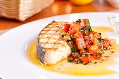 Grilled halibut with corn coconut milk sauce and cherry tomato chutney