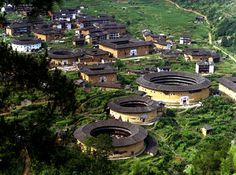The Tulou buildings in the Fujian Province in southeastern China built with rammed earth is a World Heritage site; http://www.chinadaily.com.cn/regional/2008-07/07/content_6824333.htm#