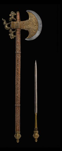 TABAR, Battle Axe with dagger: 19th century  Northern India  Steel, copper, brass.