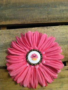 Large pink daisy with Vampire Cupcake flattened bottlecap center. $6.00, via Etsy.
