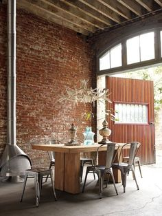 Exposed brick wall, wood dining table, metal chairs, antler chandelier, intriguing space Dining Room Design By Marais Industrial Interior, Home, Dining Room Design, House Styles, Teak Dining Table, House Design, Exposed Brick Walls, Interior Design, House Interior