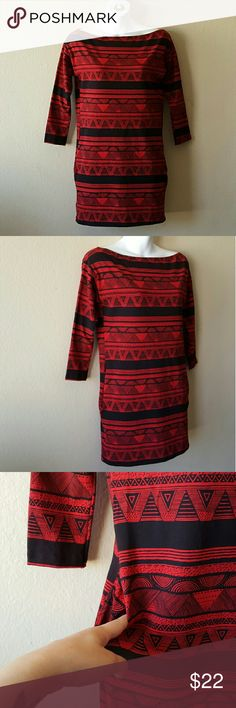 "American Apparel ""Afrika"" Black & Red Print Dress NO-TRADES  Cross posted  Model stats: 36B bust, 5'3 height, 10 ( med-lrg) in dresses.   In good condition! No holes or stains, but the black will look kinda brown in certain lighting. The red bled through the black when washed; kinda inevitable. This is one size and will fit up to a medium 10. Sleeves are 3/4 and there are 2 side pockets. American Apparel Dresses Mini"