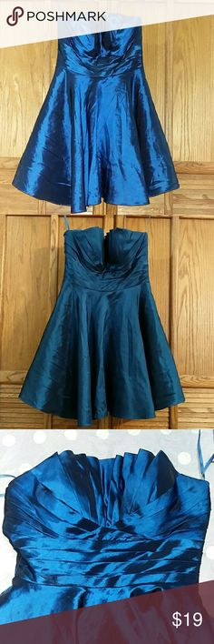 Cinderella Designs Prom / Homecoming Dress. Sz S Electric blue CINDERELLA DESIGNS / Cinderella Couture formal/prom/homecoming/pageant dress! Sweetheart neckline with ruching. Lightly padded bust. Lined. Tulle. Zippered back. Excellent condition.   Size Small.  Approximate measurements of the dress are Bust 16 inches (measured side to side), Waist 13 inches, and Length 24 inches.   Retails $150. Don't miss this amazing deal! Cinderella Dresses Prom