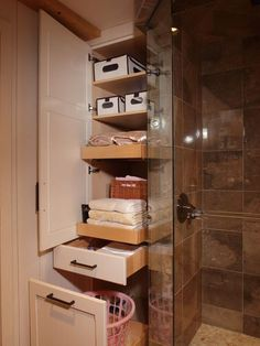 I like the idea of a pullout drawer at the bottom of our linen closet for a hamper Country Oasis - traditional - bathroom - minneapolis - Sawhill - Custom Kitchens & Design, Inc. Built in cabinet at the end of the shower/tub? Bathroom Storage Solutions, Small Bathroom Storage, Bathroom Closet, Basement Bathroom, Bathroom Organization, Organized Bathroom, Small Bathrooms, Small Storage, Towel Storage