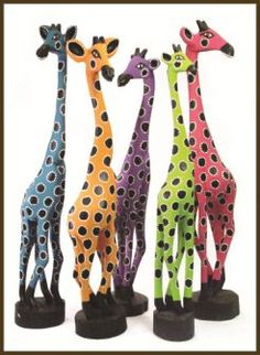 Gorgeous colourful wooden giraffes #africa #art #animals