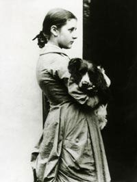 Beatrix Potter at fifteen years with her springer spaniel, Spot ~ Born into a privileged household, Beatrix was educated by governesses and grew up isolated from other children. She had numerous pets and spent holidays in Scotland and the Lake District, developing a love of landscape, flora and fauna, all of which she closely observed and painted.