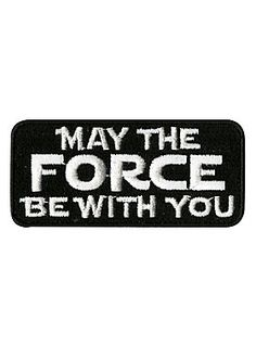 """<p>Black iron-on patch from <i>Star Wars</i> with embroidered """"May The Force Be With You"""" text design.</p> <ul> <li>2 3/4"""" x 1 1/4""""</li> <li>Imported</li> </ul>"""