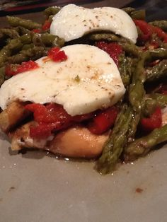 My crockpot chicken, asparagus and roasted red peppers, soaked in balsamic vinaigrette and topped with dress mozzarella. Made it as a freezer meal and threw it in the crockpot on low for 5 hours. Delicious!