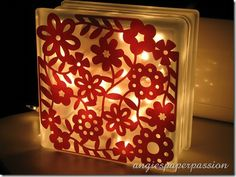 Glass block decoration. We picked up a plain glass cube at A.C. Moore today for 4.97. There are million possibilities for fun kids projects using these.