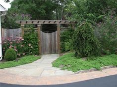 Gate Pergola  Gates and Fencing  Sitescapes Landscape Design  Stony Brook, NY  Like the planting and layout.