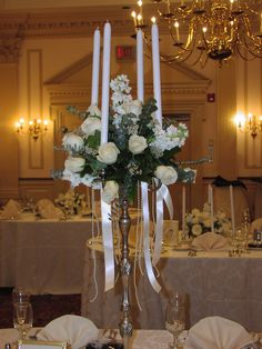 Candelabra filled with pastels and ribbons and pearls cascading.