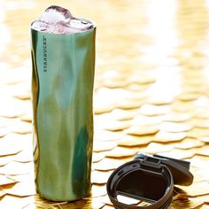 A Slender Stainless Steel Coffee Tumbler With A Quilted