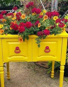 Turn an old sewing machine cabinet into a planter.