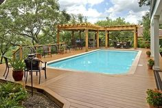 Relax in comfort and style around a pool with low maintenance composite decking and shade pergolas too. | archadeck.com