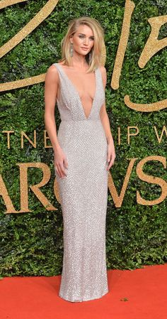 Rosie Huntington-Whiteley wears deep plunge v-neck Burberry dress at the British Fashion Awards.