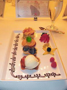 waldorf pudding, peaches chartruese jelly, chocolate and vanilla eclairs, vanilla ice cream, fruit