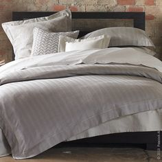Spice up any bedroom ensemble with Peacock Alley's, Corsica, a contemporary yarn-dyed herringbone jacquard.  This handsome, two-toned pattern is finished with a satin stitch detail on the trim of the duvet covers and shams.