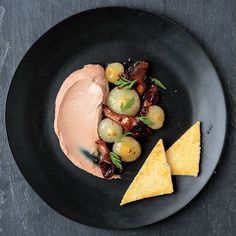 Duck Liver Mousse with Cipolline Onions and Mushrooms - SAVEUR - In this creamy, refined version of liver and onions, from Toronto's The Black Hoof restaurant, ethereal duck liver mousse pairs with caramelized cipolline onions and mushrooms.