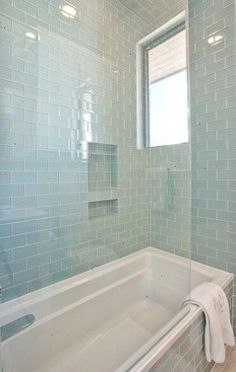 Glass subway tiles | Cat Mountain Greenbelt Homes Austin TX contemporary bathroom