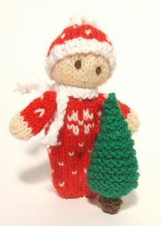 Christmas Bitsy Baby is snuggly and warm in a Christmas Snow Suit with a matching hat and scarf Bitsy is so excited to be bringing home the Christmas tree and can't wait to start decorating it! Knitting Pattern by Claire Fairall